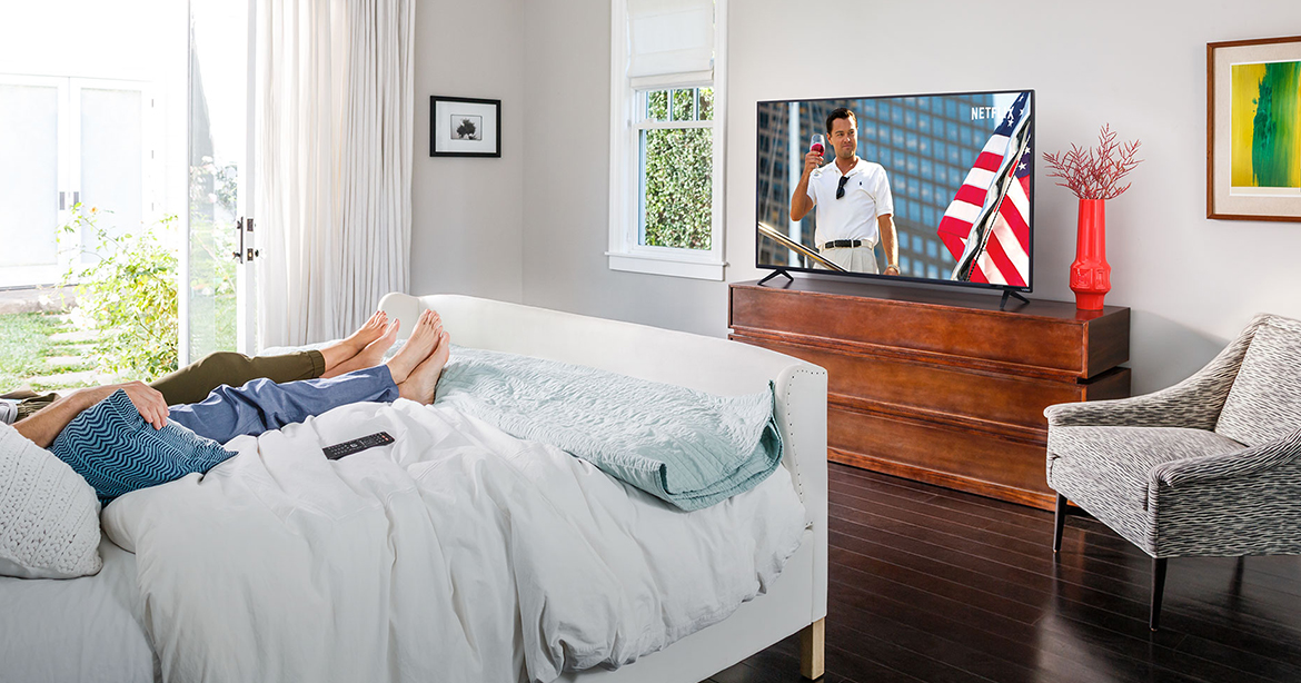 Lifestyle bedroom image, D-Series Tv showing Wolf of Wall Street