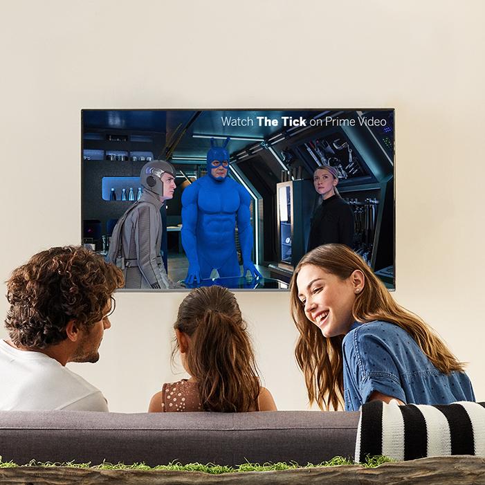 Family gathered around TV